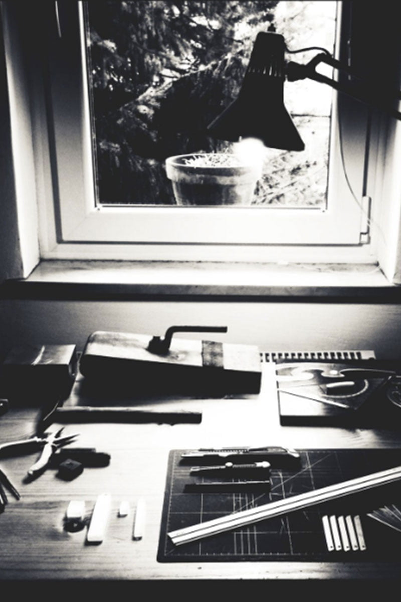 black and white photo with vintage desk and custom framing tools