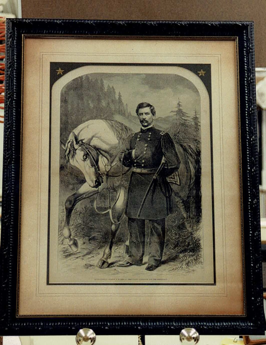 a antique photo of a soldier standing beside a horse within a archive photo frame