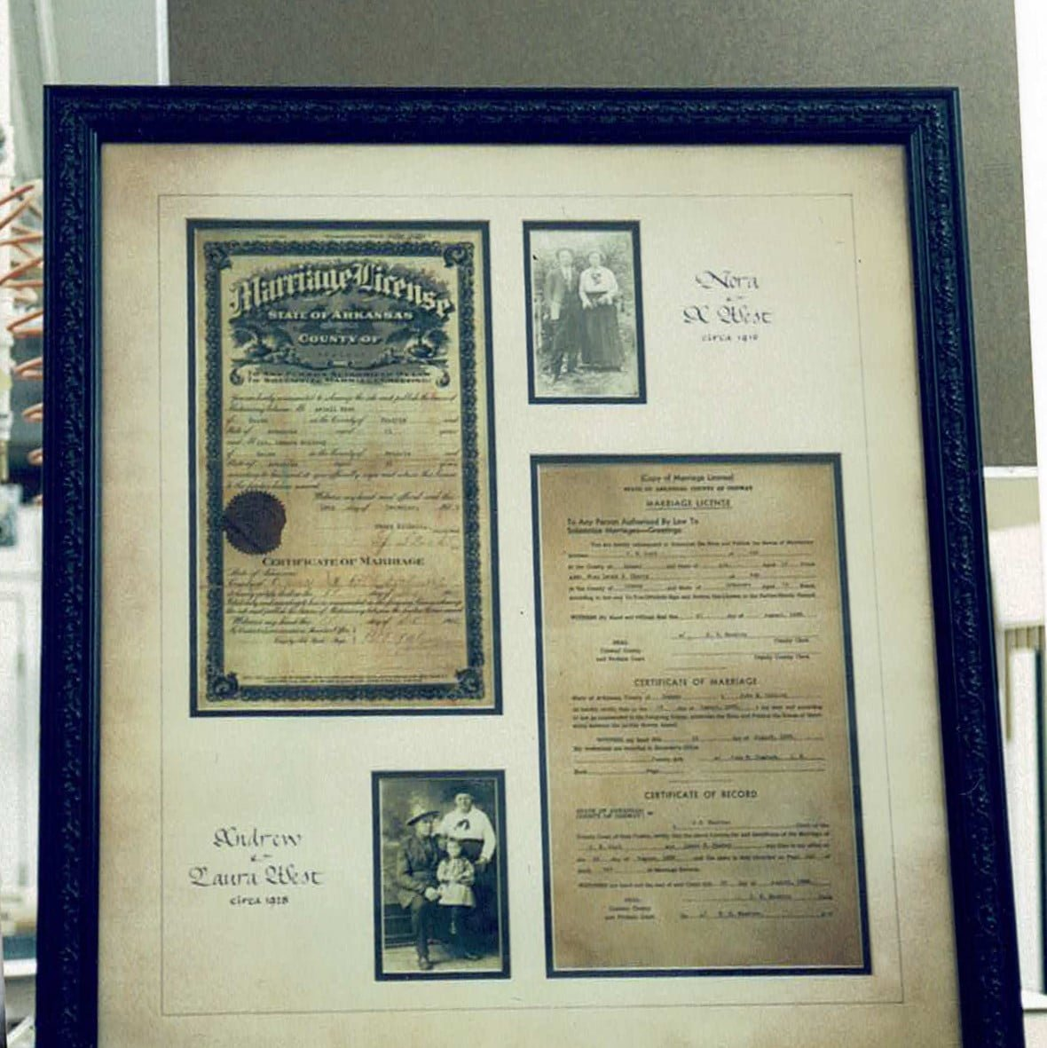 vintage photography and diplomas within a custom built photo archival frame