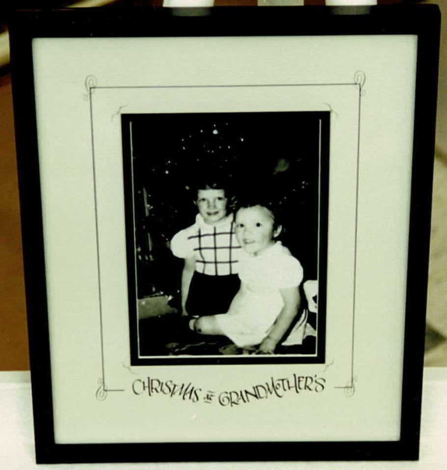 photo of two grand children in our custom photo matting and frame